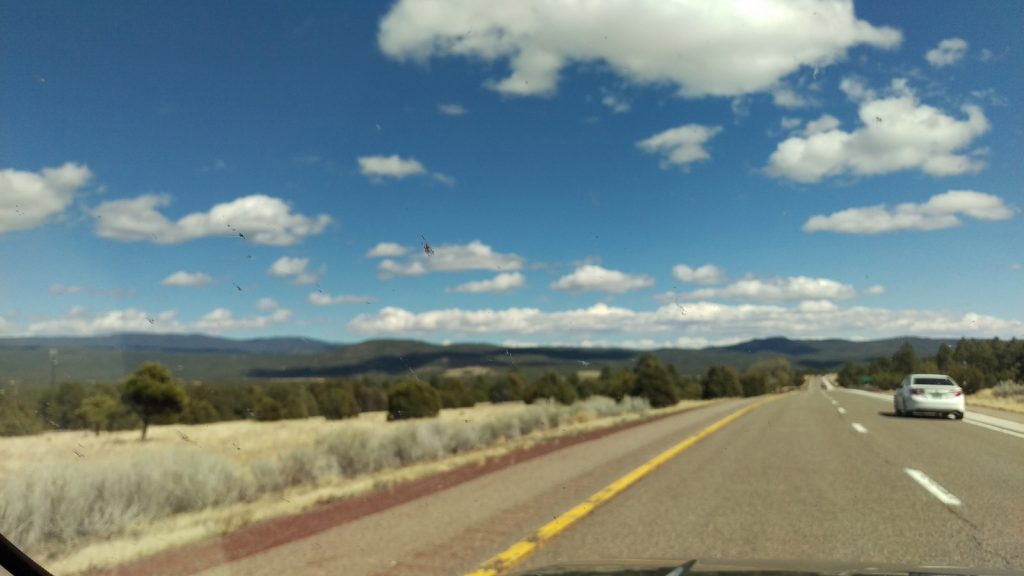 Past Santa Fe, at a point where enough bugs had splatted on the windshield that it confounded the autofocus.