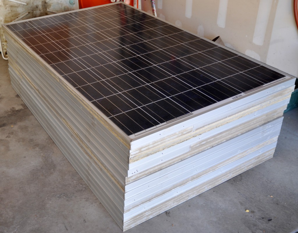 Stack of solar panels in a garage