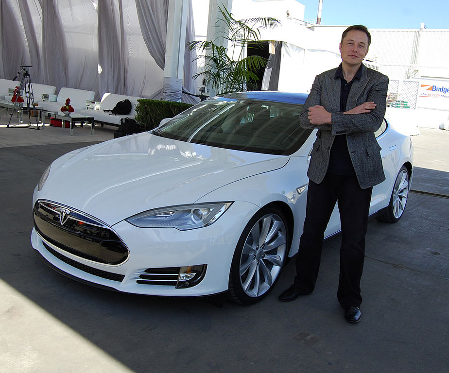 Elon Musk with a Tesla Model S outside Tesla's Freemont, Calif., factory