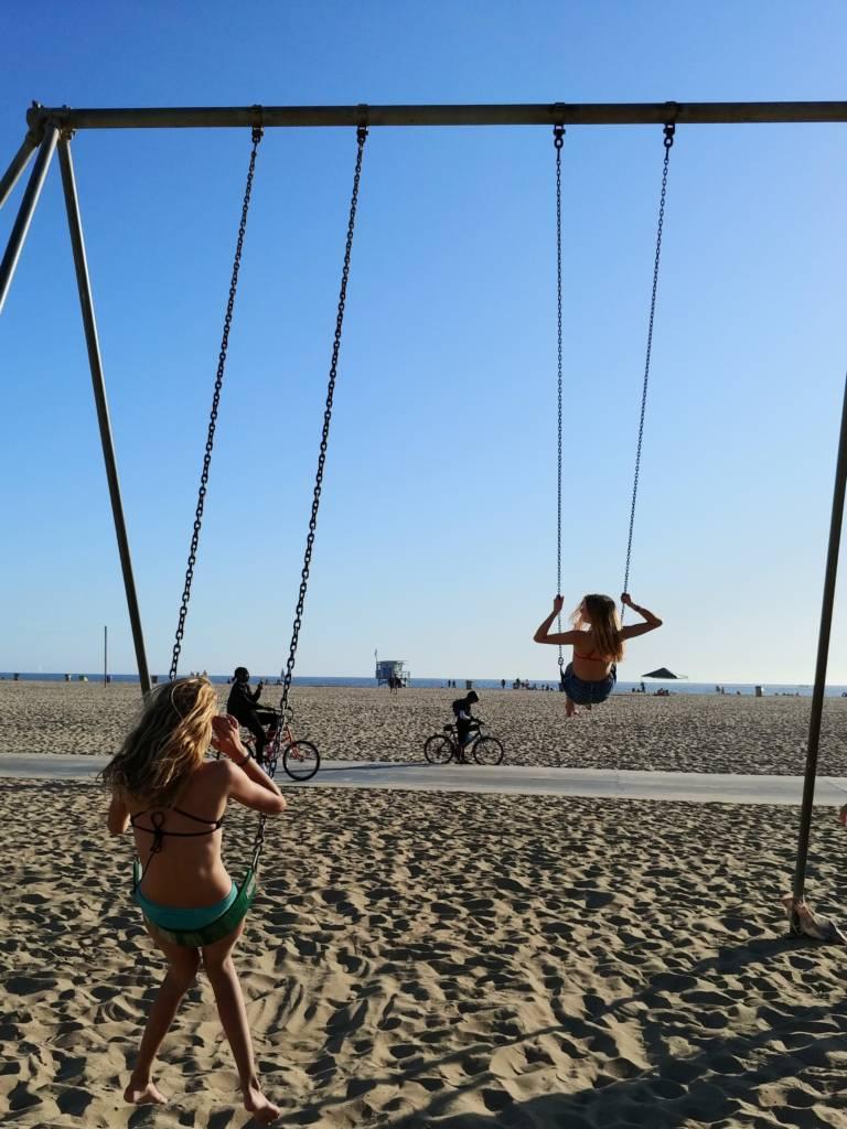 On the Santa Monica Muscle Beach swings