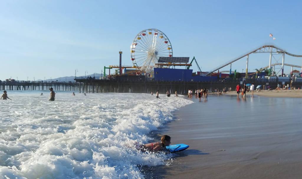 Bodyboarder and Santa Monica Pier